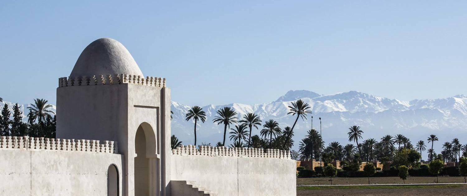 White temple in Marrakech in front of mountain panorama