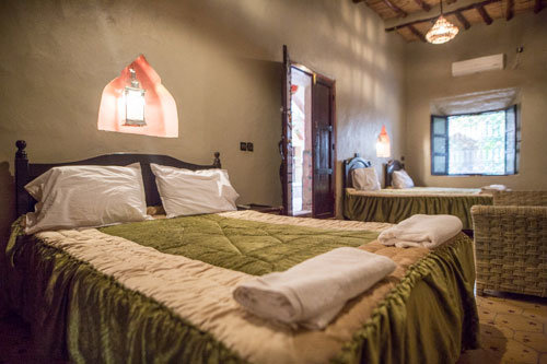8-day round trip south Morocco, standard multi-bed room in a hotel in the oasis Fint in Morocco